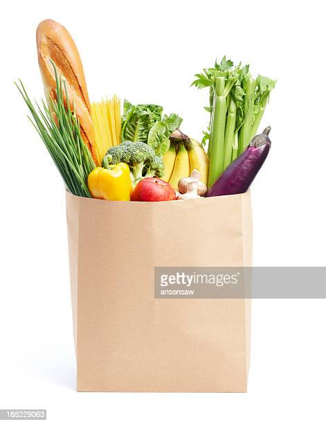 groceries in paper bag - bag stock photos and pictures