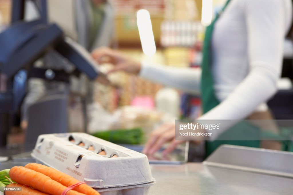 Groceries on check out counter : Stock Photo
