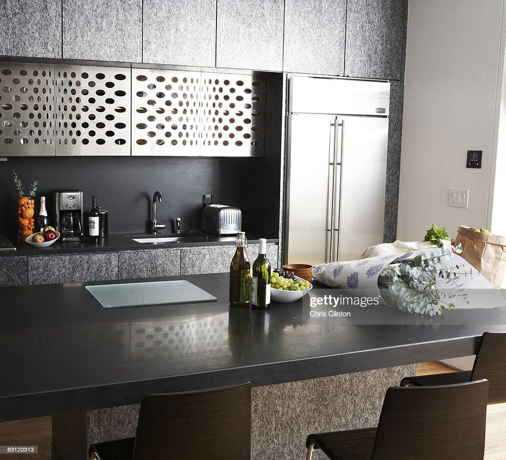Groceries on counter in modern kitchen : Bildbanksbilder