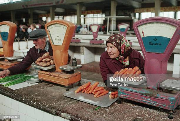 Grocers sell vegetables at an expensive open air market run by the Sovet government in Knovokuznetsk, Siberia, USSR.