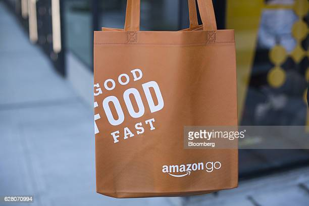 A grocery bag is displayed for a photograph outside the new Amazon Go grocery store in Seattle Washington US on Tuesday Dec 6 2016 Amazoncom Inc...