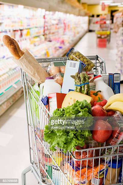 grocery cart full of groceries - full stock pictures, royalty-free photos & images