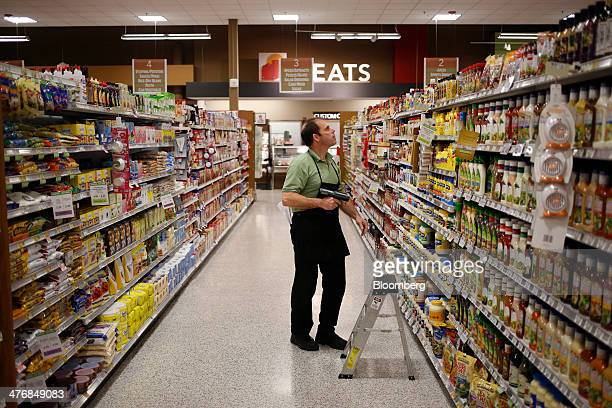 Grocery clerk James Delarosa takes inventory of the salad dressing and condiments aisle at a Publix Super Markets Inc grocery store in Knoxville...