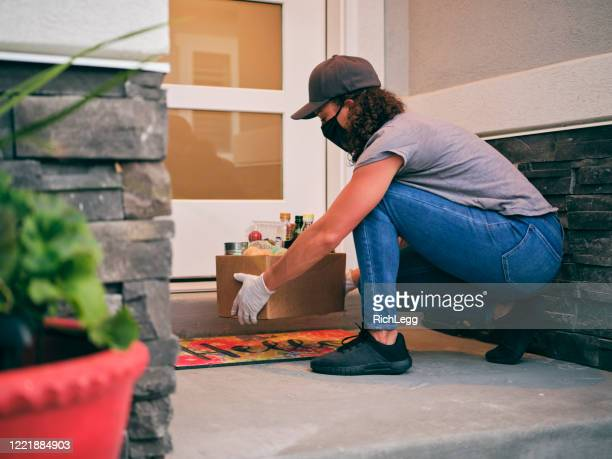 grocery delivery person - black glove stock pictures, royalty-free photos & images