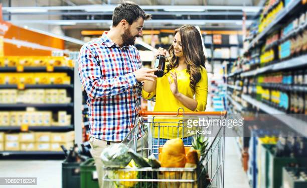 grocery shopping. - men bulges stock photos and pictures