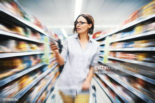grocery shopping. - consumerism stock pictures, royalty-free photos & images