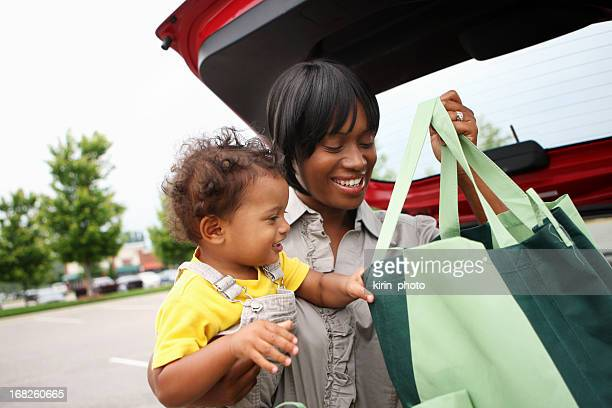 grocery shopping - black boot stock pictures, royalty-free photos & images