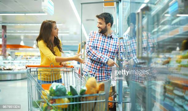 grocery shopping - freezer stock photos and pictures