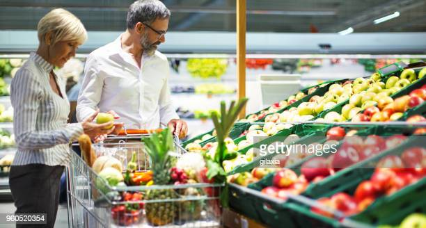 grocery shopping - produce aisle stock photos and pictures