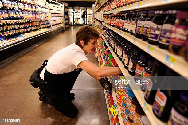 Grocery stocker Kris Huerta stocking the shelves at Wellington's Main Street Market The towns only major grocery store is closing after five years...