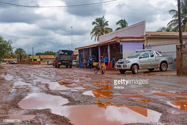 Grocery store along muddy dirt road in the village of Lethem during the rainy season, Upper Takutu-Upper Essequibo region, Guyana, South America .