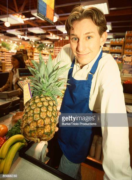 Grocery store cashier with pineapple