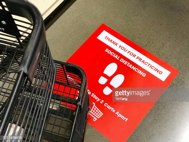 covid-19 grocery store checkout line social distancing sign notice - covid icons stock pictures, royalty-free photos & images