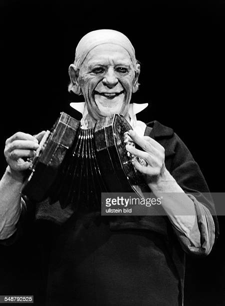 Grock Clown Comedian Pantomime Composer Switzerland *10011880 during a show with a bandoneon 1950 Photographer Jochen Blume Vintage property of...