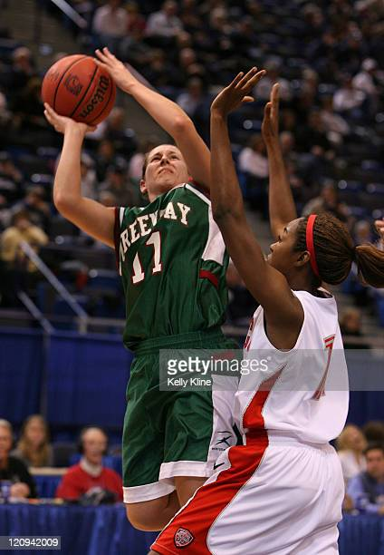 Groh of UWGreen Bay putting up a jumper over a NM Lobo defender at the Hartford Civic Center in Hartford CT on March 18 2007