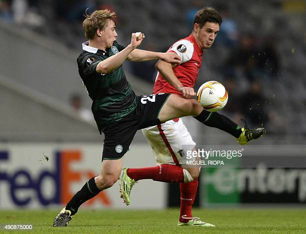 Groningen's Swedish midfielder Simon Tibbling vies with Sporting Braga's forward Rui Fonte during the UEFA Europa League group F football match SC...