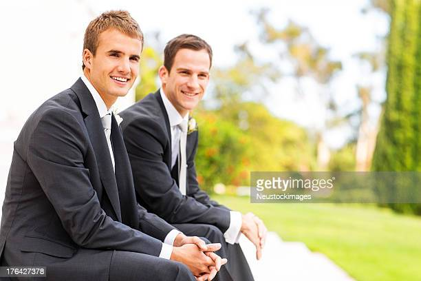 Groom And Best Man Sitting With Hands Clasped