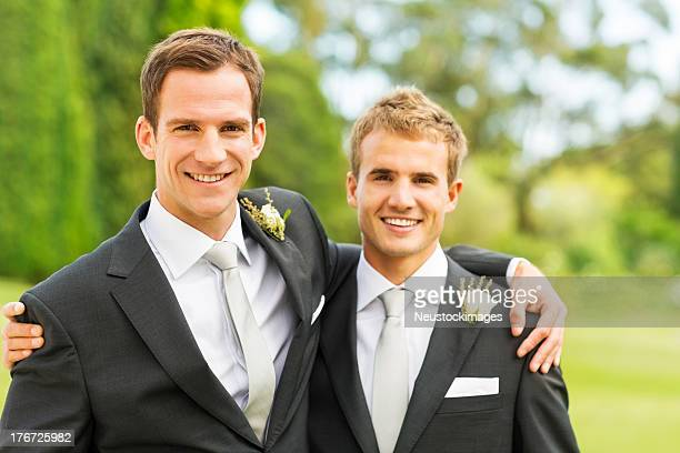 Groom And Best Man With Arms Around Each Other
