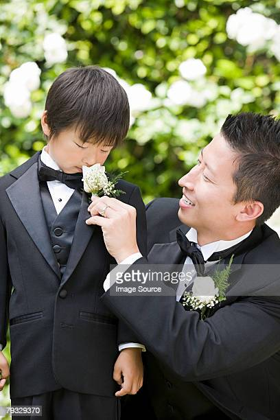 groom and boy smelling flower - ring bearer stock pictures, royalty-free photos & images
