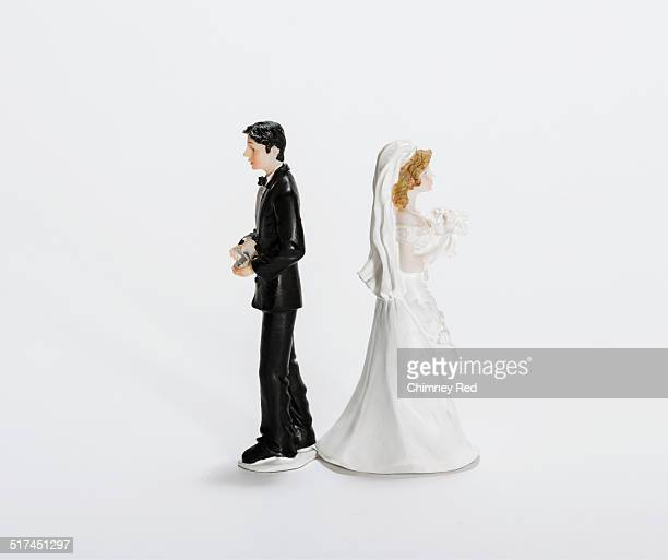 Groom and Bride cake toppers back to back