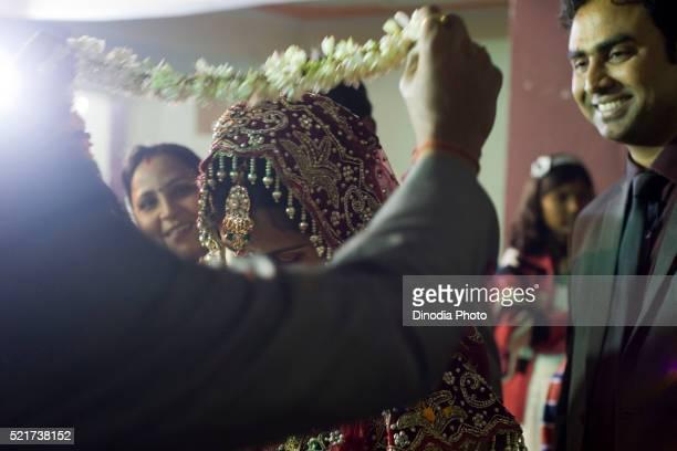Groom and bride in wedding jaimala ritual, Uttar Pradesh, India, Asia