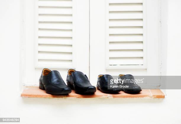 Groom and ring bearer shoes on a window sill