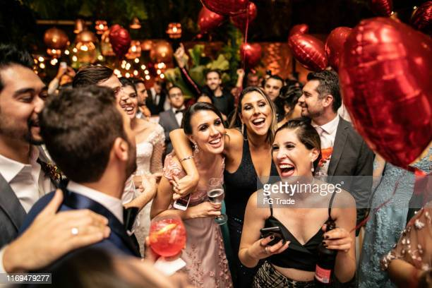 groom and wedding guests laughing during party - cerimonia di nozze foto e immagini stock