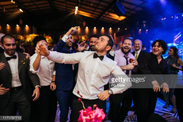 groom and wedding guests laughing during party - wedding guest stock pictures, royalty-free photos & images