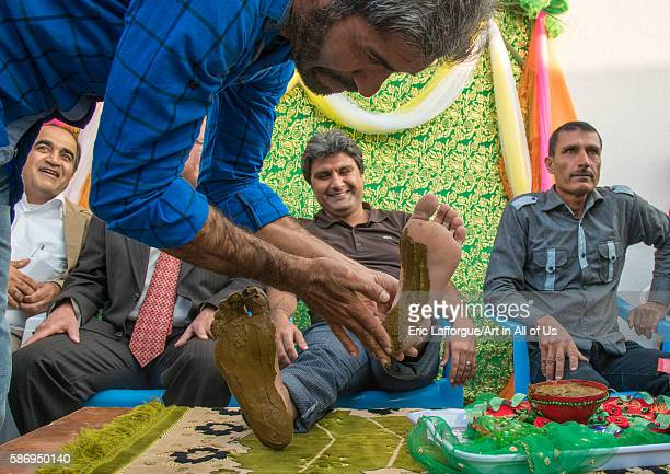 Groom being covered with henna during his wedding ceremony hormozgan kushkenar Iran on December 29 2015 in Kushkenar Iran