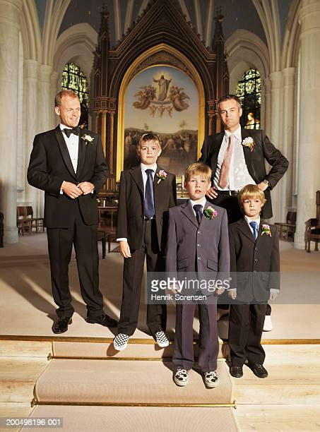 Groom, best man, and boys (5-10) standing at alter of church