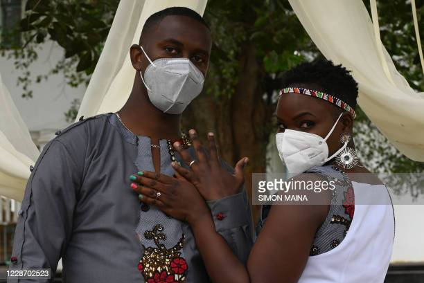 Groom Charles Otieno and bride Jackline Adhiambo, pose for photos during their wedding in Nairobi on September 25 attended by few relatives, and...