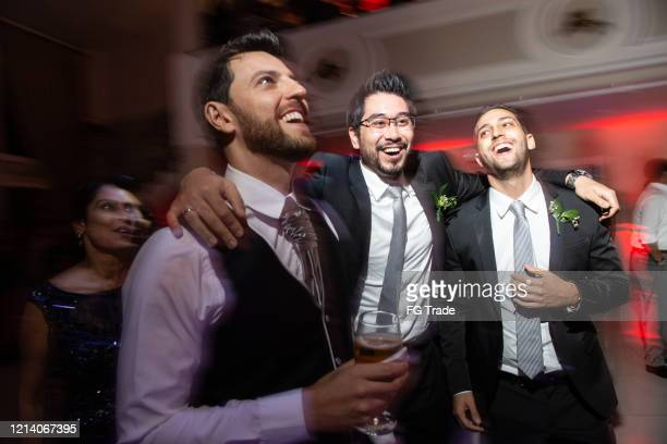 groom dancing with friends enjoying wedding