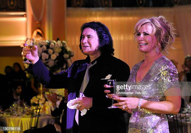 Groom Gene Simmons and Bride Shannon Tweed toast at their wedding held at the Beverly Hills Hotel on October 1 2011 in Los Angeles California