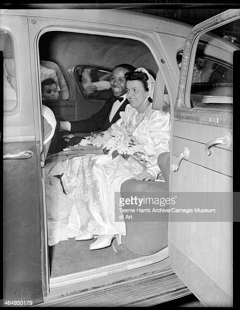 Groom George Edward Webster and bride Mary Louise Jeffries Webster posed in backseat of car Pittsburgh Pennsylvania June 1942
