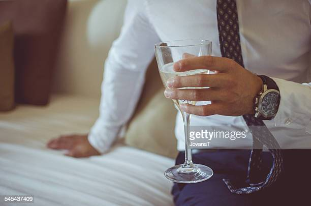 Groom holding a glass of champagne