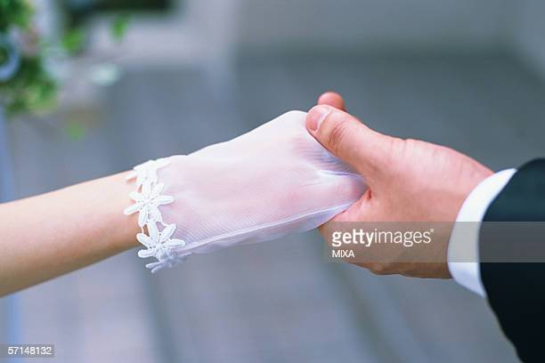 Groom holding a hand of a bride
