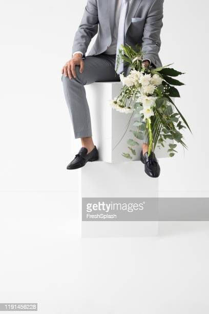 groom holding wedding bouquet - loafers stock pictures, royalty-free photos & images