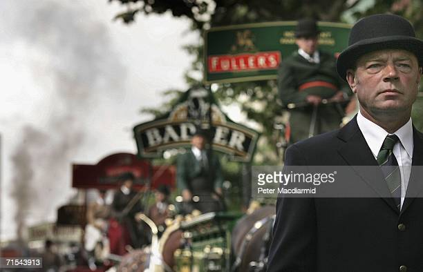 Groom in a bowler hat walks with traditional brewer's wagons before the start of the Great British Beer Festival on July 31, 2006 in London. The...