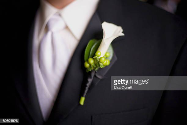 Groom in white tie wearing boutonniere