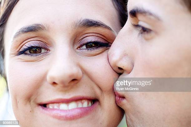 groom kissing cheek - cheek stock pictures, royalty-free photos & images