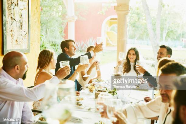 groom leading toast during outdoor wedding reception at tropical resort - 30 39 years stock pictures, royalty-free photos & images