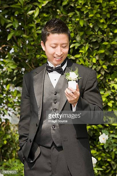 Groom looking at ring