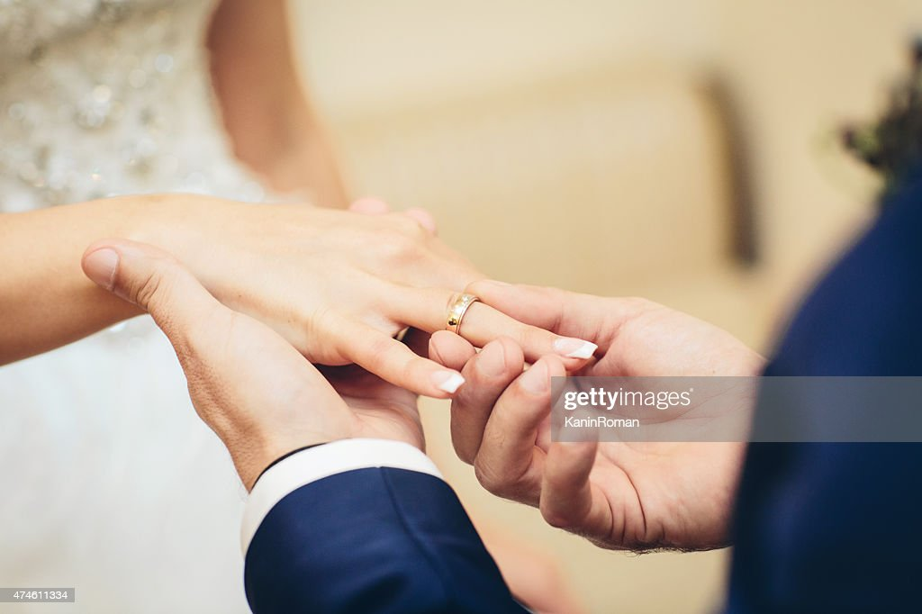 Free wedding ring hands wedding ring Images Pictures and Royalty