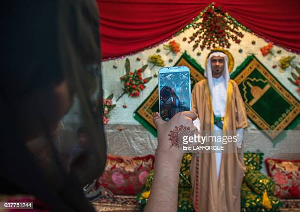 Groom posing for a mobile phone picture with his new traditional clothes during a wedding ceremony on December 28 2015 in Bandare Kong Hormozgan...