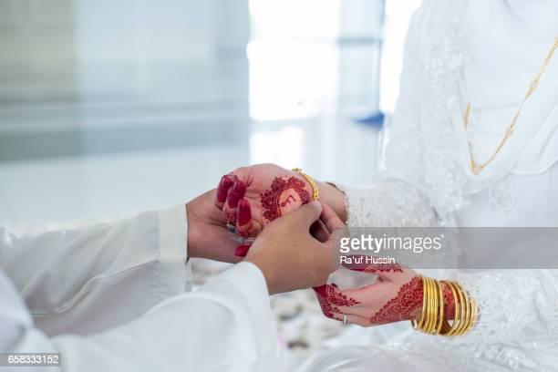 Groom Put the Wedding gold bracelet on bride