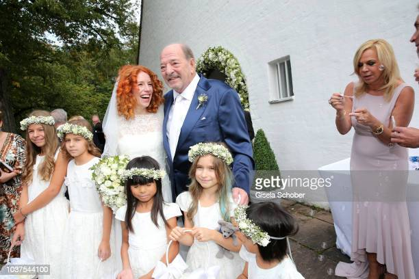 Groom Ralph Siegel and bride Laura Kaefer after their wedding at the Thomaskirche Gruenwald on September 15 2018 in Munich Germany