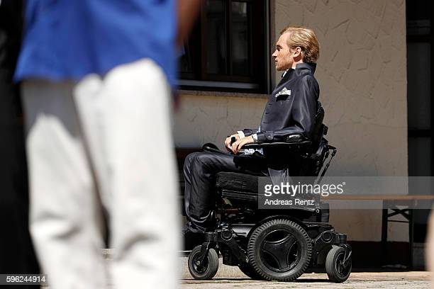 Groom Samuel Koch waits for his bride Sarah Elena Timpe at the local church on August 27 2016 in Mappach near EfringenKirchen Germany
