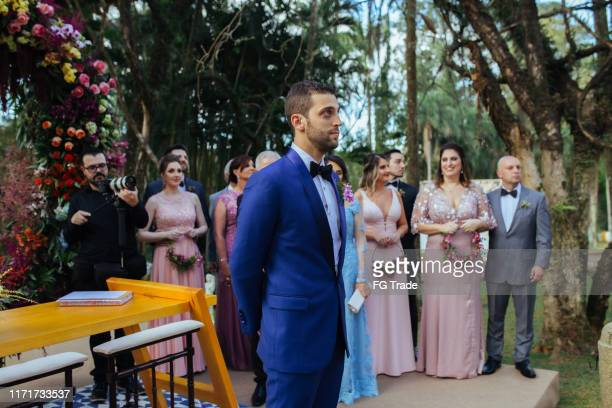 groom waiting the bride in the altar - waiting stock pictures, royalty-free photos & images