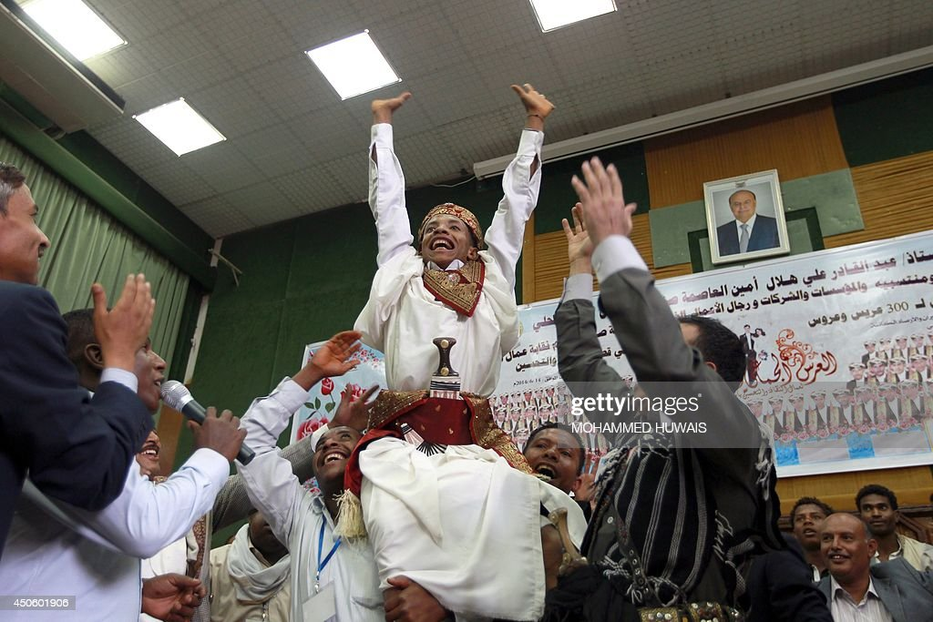 A groom, who is an employee of the Sanaa Municipality, celebrates during a mass wedding ceremony on June 14, 2014, in the capital Sanaa. The ceremony was organized by the municipality for 350 members of its staff.