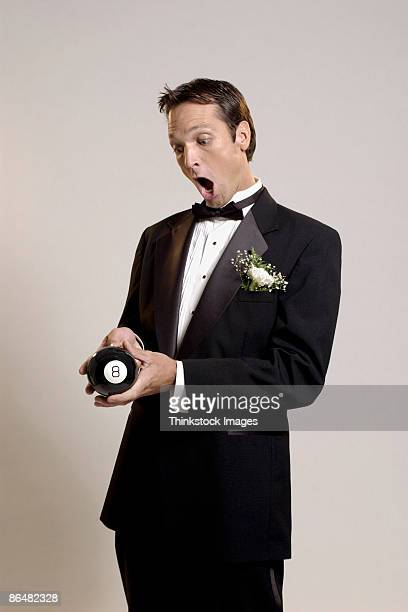 Groom with eight ball